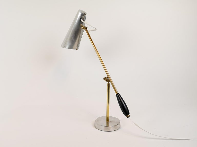 1950s Birger Dahl Modell: S-30016 table lamp for Sonnico, Norway. This architectural table lamp was designed in 1952 and made in polished metal with exquisite brass details. This lamp is a stunning piece of design.  Rewired electricity  Good