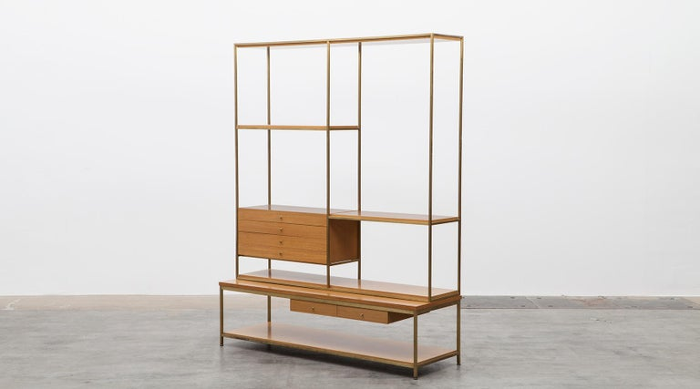 Mahogany shelf, brass base by Paul McCobb, USA, 1954.  A timeless shelf designed by American Paul McCobb with a lot of storage spaces. Six drawers in two different sizes and six shelves are hold and bordered by a brass frame. Corpus is in bleached