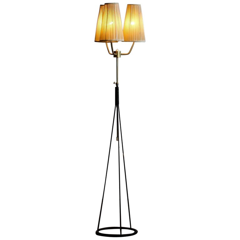 Extreme beautiful floor lamp by Falkenbergs Belysning. The typical open base is made of metal and built up with brass parts with making it in total very beautiful. E26 and E27 screw lamps 110 and 220 volts. Measures: The height is adjustable