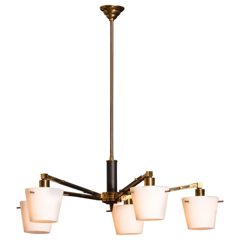 Beautiful and original midcentury chandelier with five frosted white glass shades on a brass frame by Stilnovo Italy. Period: 1950s. Five lights. Technical 100% / E14 / 17. The dimensions are ø of the fixture, 65 cm / 26 inch. Total height 70 cm /
