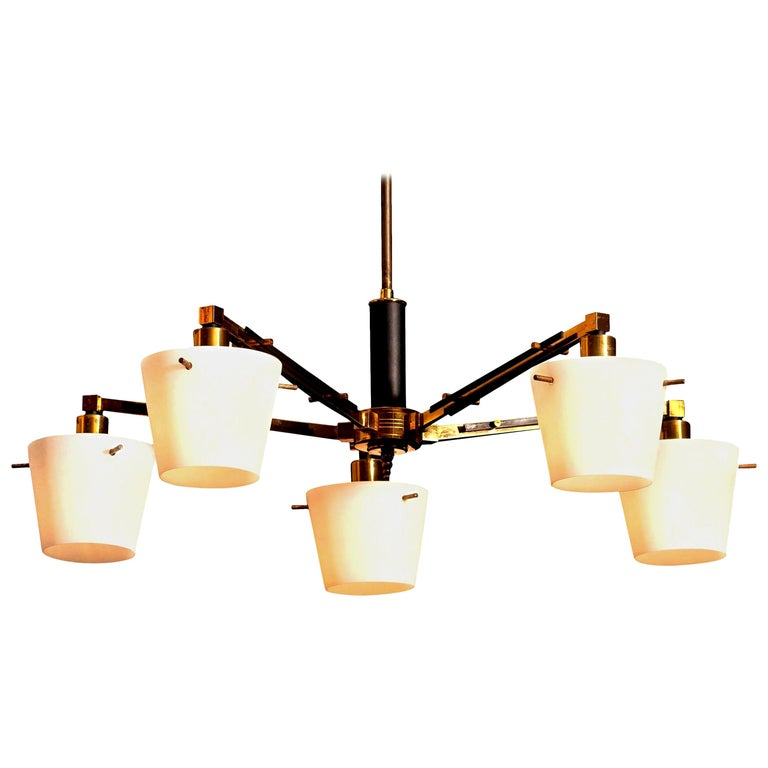 Beautiful and original midcentury chandelier with five frosted white glass shades on a brass frame by Stilnovo, Italy. Period: 1950s. Five-light. Technical 100% / E14 / 17. The dimensions are Ø of the fixture, 65 cm / 26 inch. Total height 70 cm /