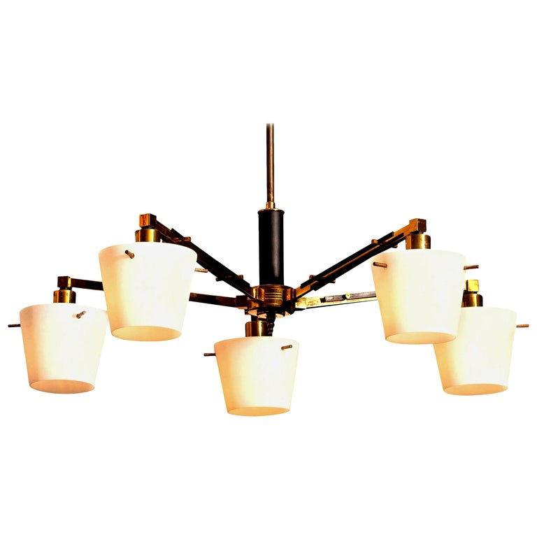 Beautiful and original midcentury chandelier with five frosted white glass shades on a brass frame by Stilnovo, Italy. Period: 1950s. Five-light.