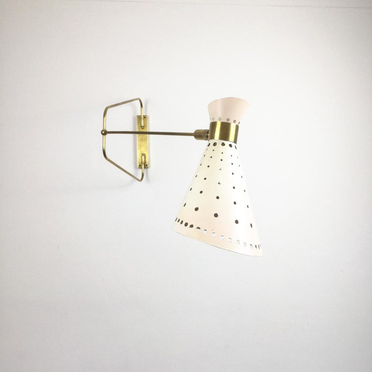 French brass articulated wall sconces in a style of René Mathieu for Maison Lunel.