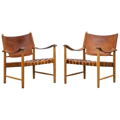 1950s Brown Leather and Oak Safari Lounge Chairs