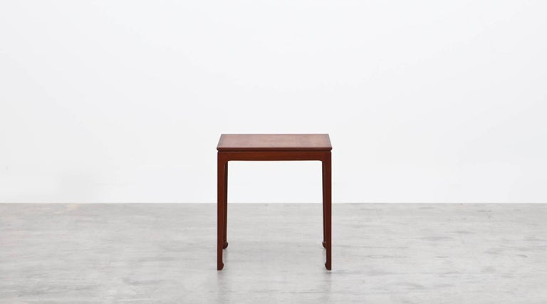 This elegant pair of side tables designed by Ole Wanscher is in mahogany. The proportions are particularly delicate and come on nicely modeled spade feet. Papers label on underside. Manufactured by A. J. Iversen.