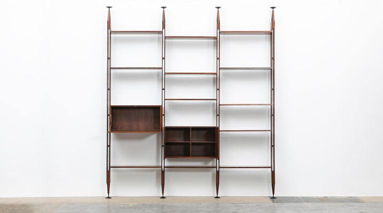 Teak and lacquered aluminum Library, Franco Ablini for Poggi, Italy, 1950.  Elegant Franco Albini library or room divider in teak comes in three rows. Shelves and the two units can be adjusted or put in different positions. The feet are in