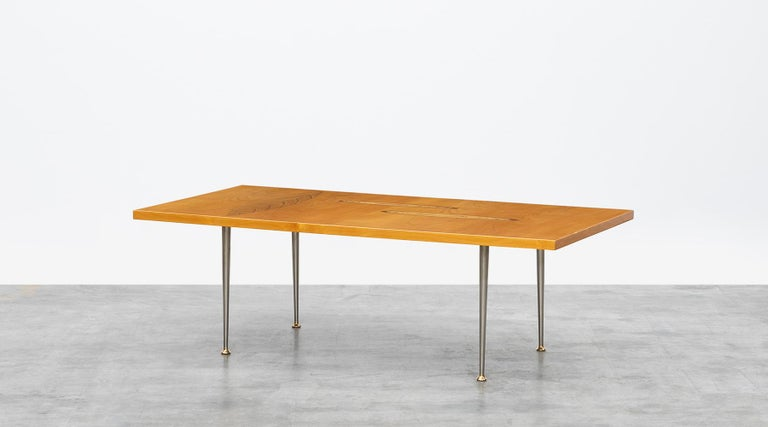 Veneered table top, metal base, Tapio Wirkkala for Asko, Finland, 1958.  Fantastic coffee table designed by Tapio Wirkkala in 1958. The veneered table top comes with a three wooden inlays in leaf ornament on a metal base. Manufactured by