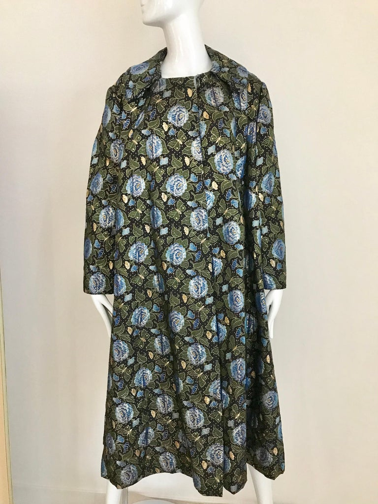"Late 50s Beautiful blue and green brocade swing coat with butterfly and flower pattern.  Size X large Bust: 52 inches/ coat length : 43.5"" Sleeve length 22 inches"