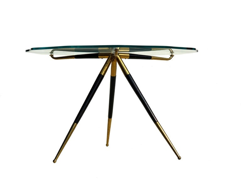 Rare coffee table. Mahogany and brass base, original 1950s crystal top. Excellent condition, glass perfect.