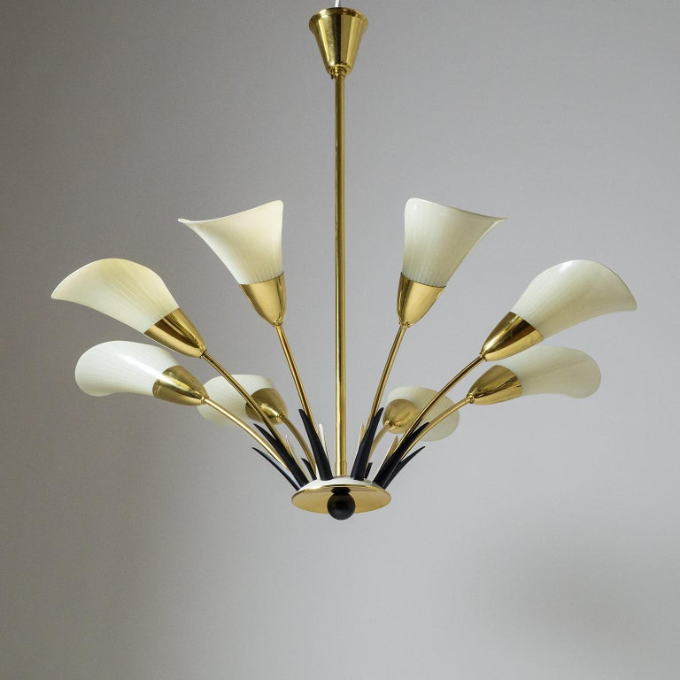 Rare eight-arm chandelier with Calla shaped glass diffusers which are enameled with an ivory colored pinstripe decor. Apart from the glass the chandelier is made entirely of brass including the lacquered parts. Beautiful delicate design with a very