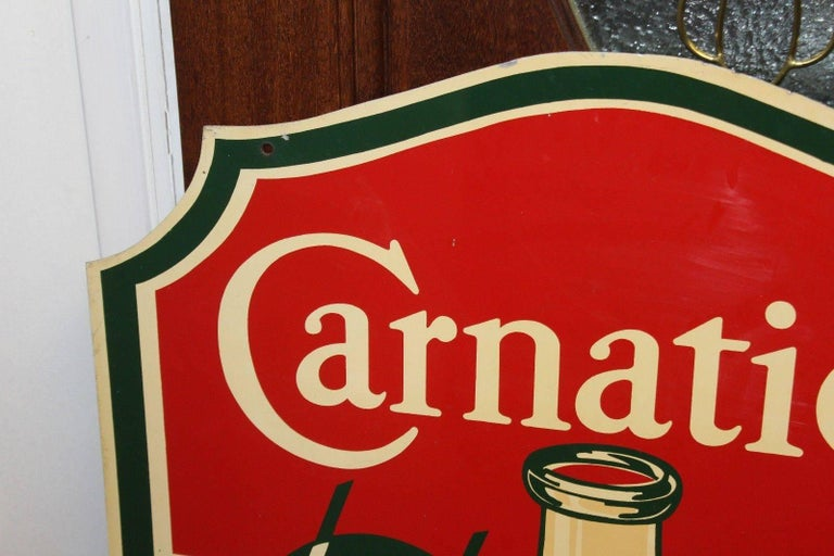 Carnation milk advertising sign was once original owned by Walt Disney Imagineer John Patrick Burke. Great original condition. Amazing die-cut shaped sign that's double sided.
