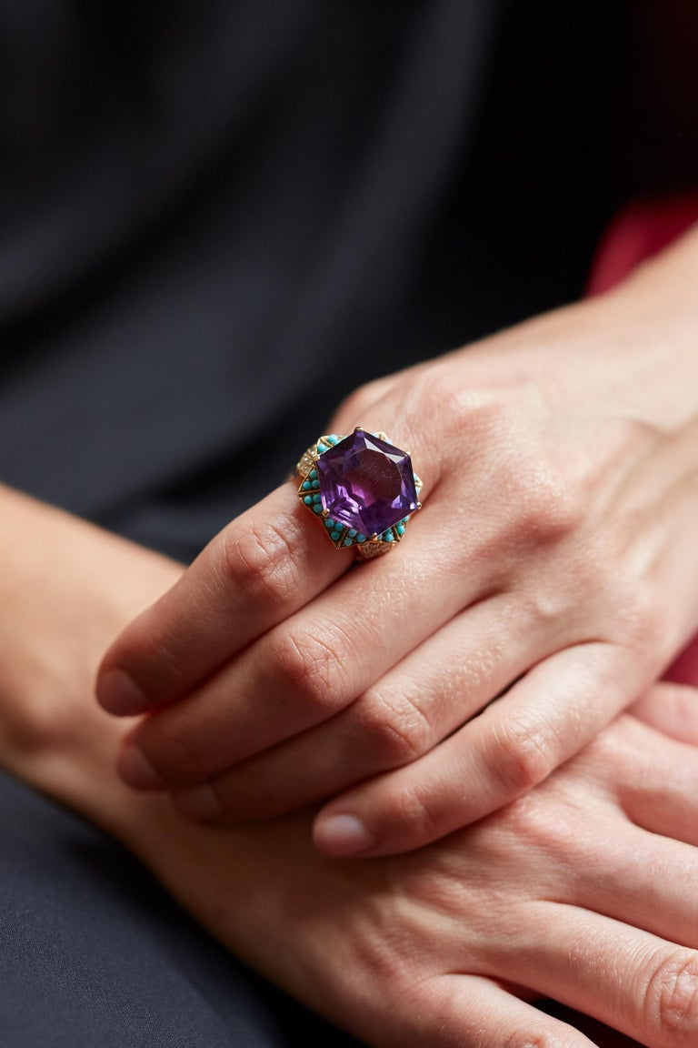 An amethyst, diamond, turquoise and 18 karat gold ring, by Cartier, c. 1950. The ring measures a size 7 and is stamped Cartier, Paris, with French hallmarks.  A bracelet of similar design was made by Cartier for the Duchess of Windsor in 1957.