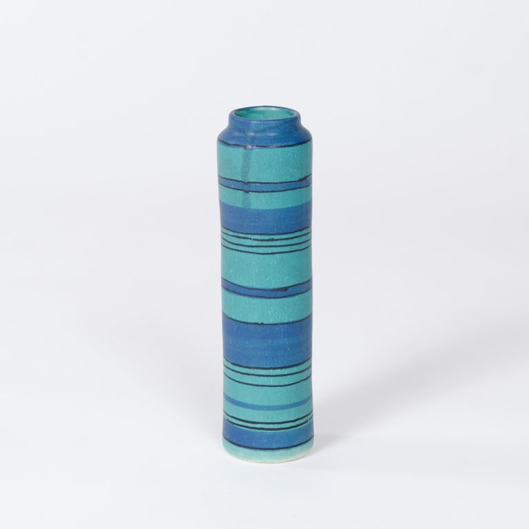 A striped, ceramic vase with satin matte glaze stamped with Glidden's ram head mark and signed