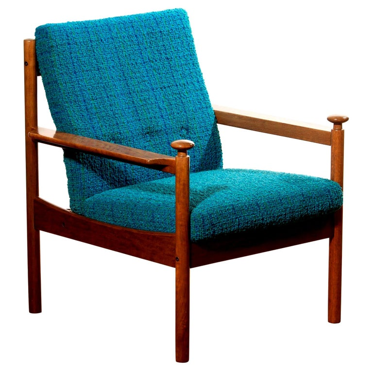 Beautiful chair designed by Torbjørn Afdal for Sandvik & Co. Mobler, Norway. The wooden frame with the blue fabric cushions makes it a very nice combination. The frame is in a good condition, only the cushions need a refilling.  Period:
