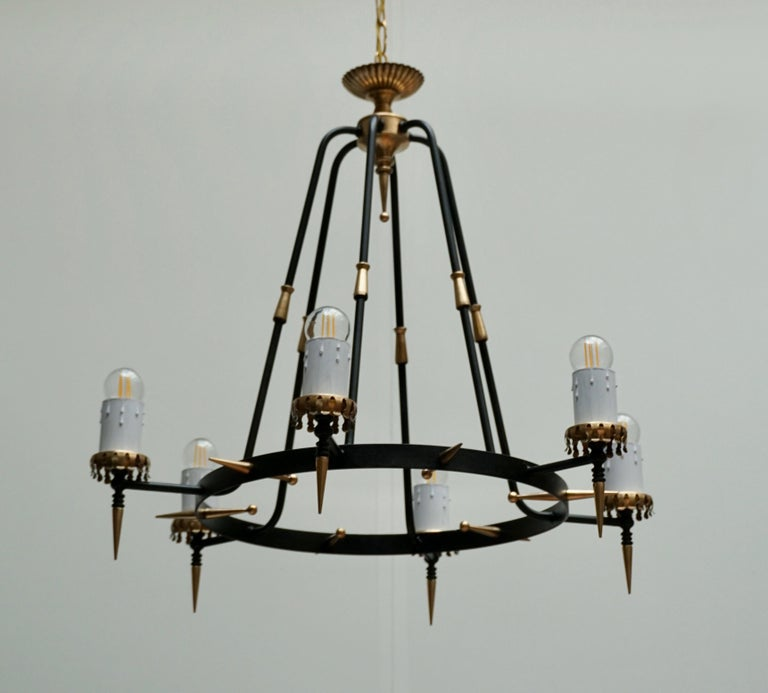 Italian chandelier in brass and black metal with six lights.