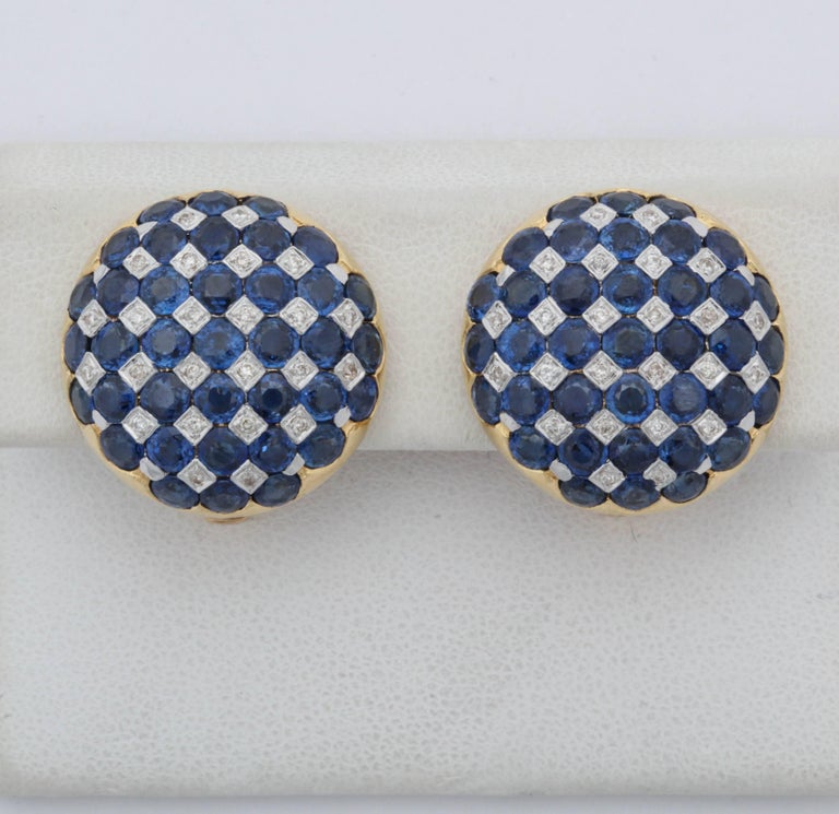 One Pair Of Ladies 18kt Gold And Numbered With a Fine Quality Jewelers serial # Designed In A Round Checkerboard Patter Of Beautiful Color Sapphires Centering Numerous full Cut Diamonds. Total sapphire Weight approximately 5 Carats , Total Diamond