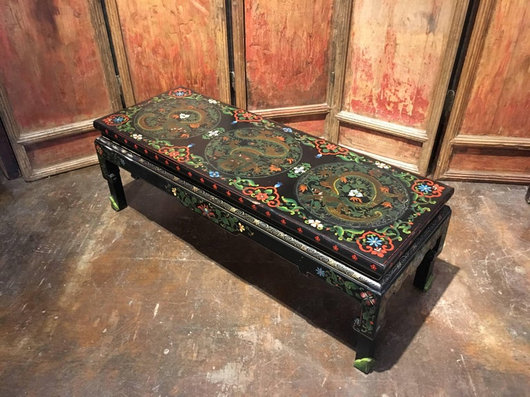 Hand-Painted 1950s Chinese Black Lacquer Painted Dragon Coffee Table or Bench For Sale