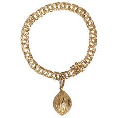 1950s Classic Double Link 18-Karat Gold Charm Bracelet with Nutmeg Charm