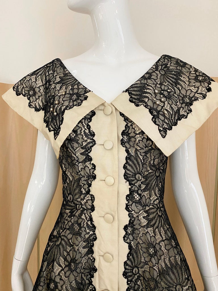 """1950s Creme Silk Dress with black lace cocktail dress with fitted waist and large lapel. Bust: 36"""" / Waist: 26"""" / Length: 43 inches"""