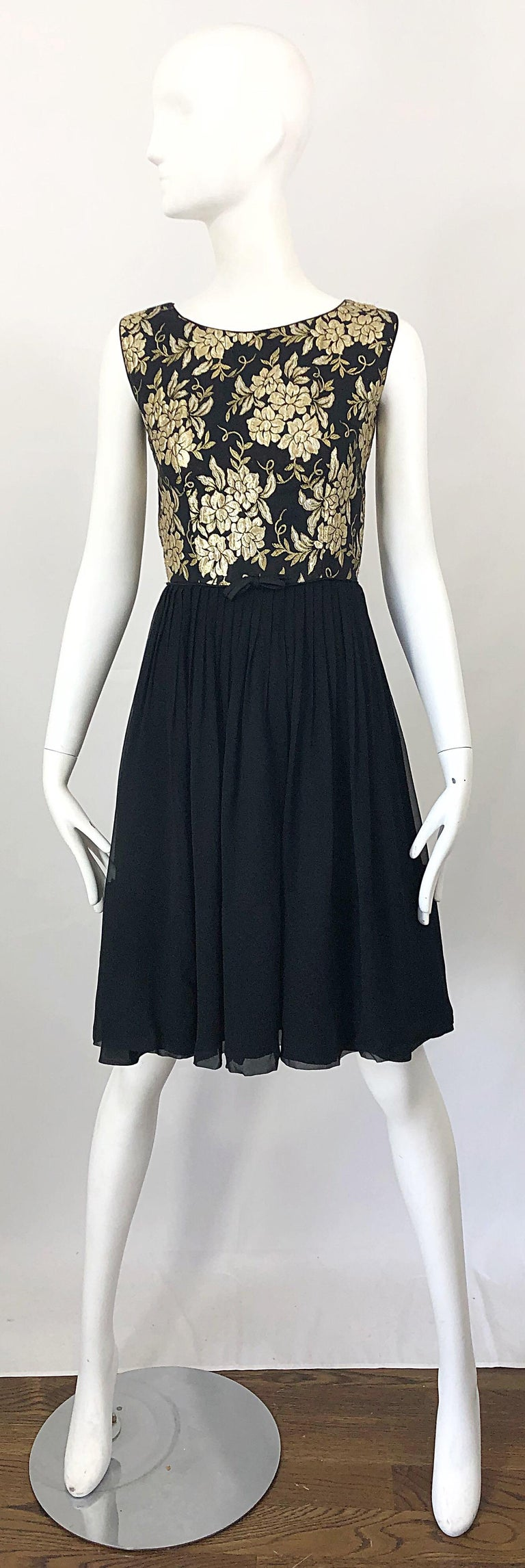 Beautiful 1950s demi couture gold and black silk brocade and chiffon cocktail dress! Features a tailored gold and black silk flower brocade bodice, with a forgiving black silk chiffon skirt. Full metal zipper up the back with hook-and-eye closure.