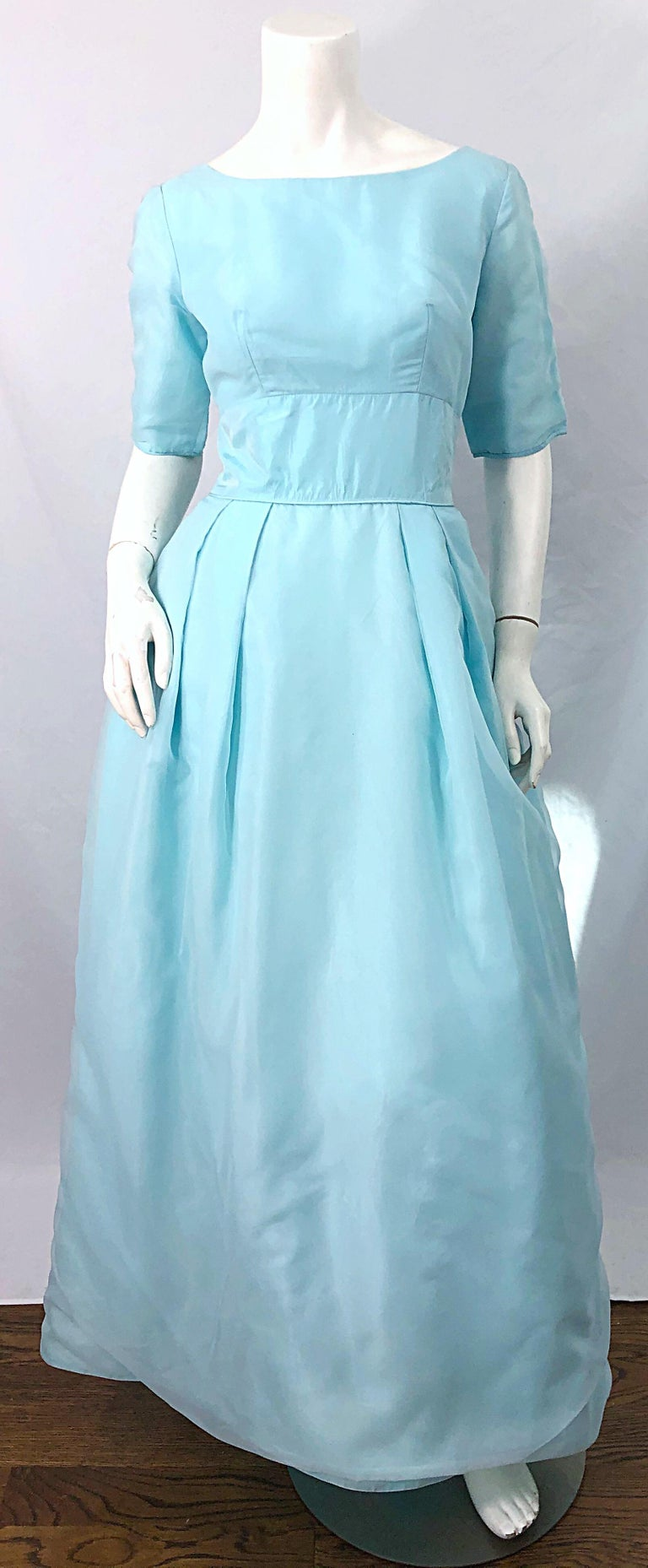 Have your Cinderella moment in this beautiful 1950s light blue silk chiffon and taffeta evening gown dress ! Features 3/4 sleeves with a tailored bodice and full skirt. Skirt has attached crinoline to add volume to the skirt. Hidden metal zipper up