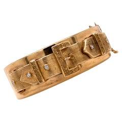 1950s Diamond Buckle Motif Hinged Bangle 14 Karat Yellow Gold Vintage Bracelet