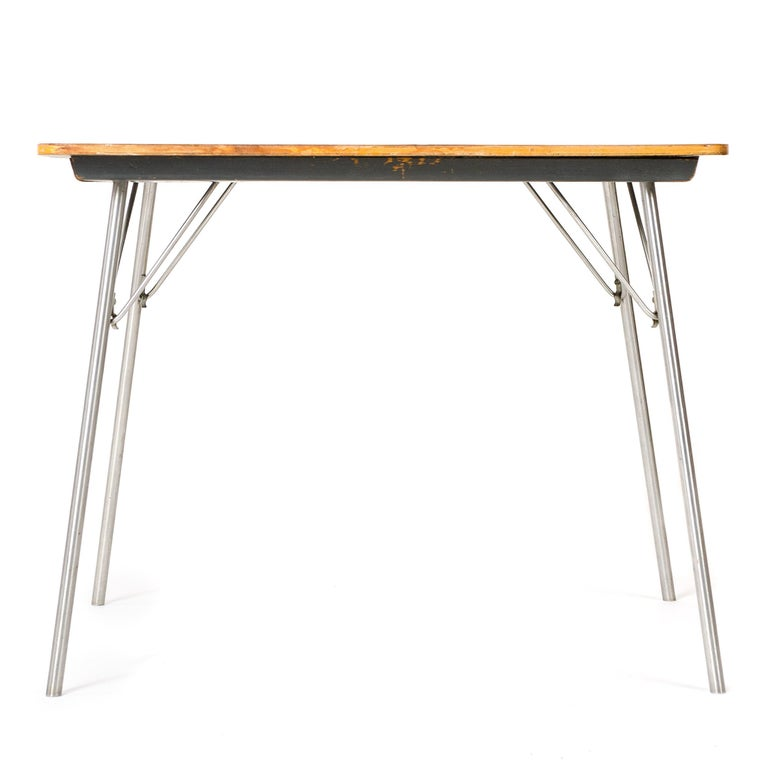 Eames for Herman Miller DTM-20 (Dining table metal Micarta top) occasional table with chrome-plated steel, lockable, folding legs suitable for uses such as light dining, card table, computer, or other ancillary use in a residential or commercial