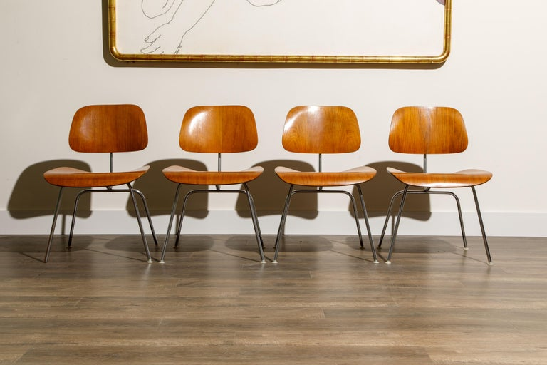 This set of four (4) early production DCM (Dining Chair Metal) chairs by Ray and Charles Eames is for Herman Millers earlier years (1956 to 1959) and therefore are collectors items and much more valuable than new production examples. Signed under