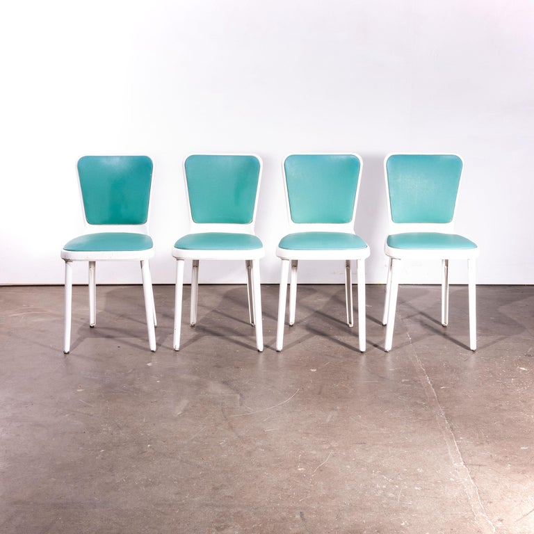 1950s Edwin Cinch set of four dining chairs  1950s vintage Edwin Cinch set of four dining chairs with original painted finish and Rexine style upholstery. Edwin Cinch was best known for his role as one of two designers (the other was Herbert