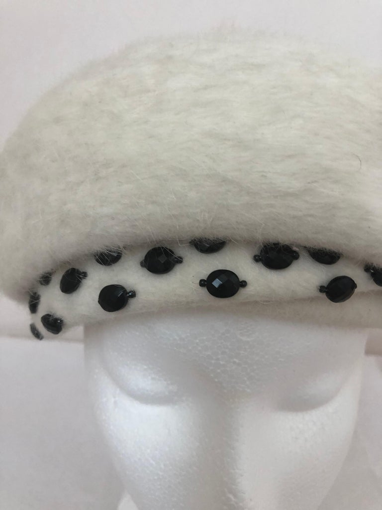 Stylish and elegant cream color fur felt hat from designer Elsa Schiaparelly manufactured in Italy by Toscana. The details are superb and include beading. Details have been captured in the photographs below.