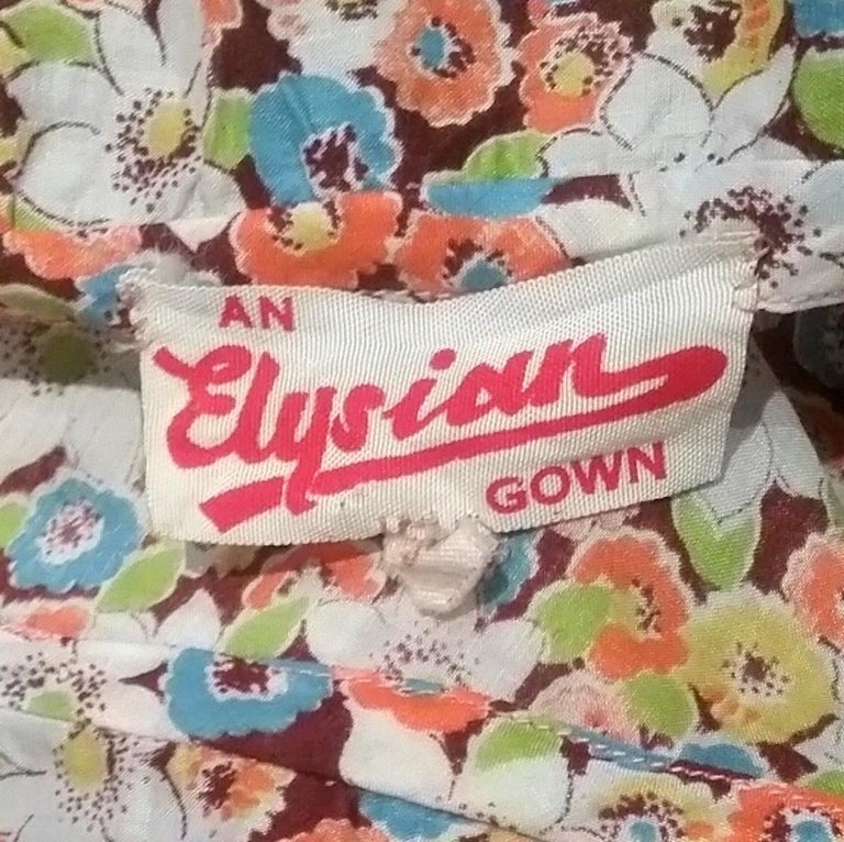 1950s Elysian Floral Cotton Dress With Asymmetrical Neckline and Peplum 1