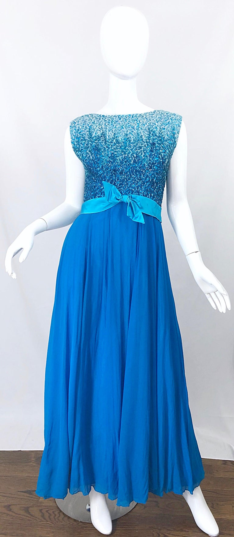 Stunning 1950s EMMA DOMB turquoise blue silk chiffon ombre sequined evening gown! Bodice features thousands of  hand-sewn sequins throughout the front and back. Full metal zipper up the back with hook-and-eye closure. Luxurious silk chiffon skirt
