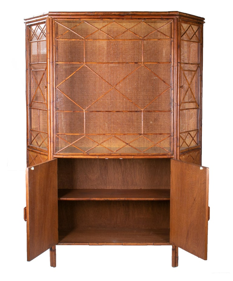 1950s English bamboo and rattan glass cabinet.