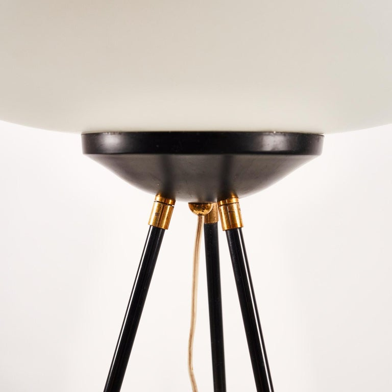 Three legged floor lamp manufactured by Chiarini in Milan in the late 1950's. Brass and lacquered brass frame, lacquered aluminium and white opaline glass shade.