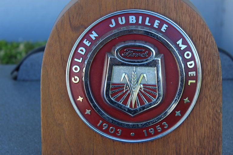 Ford Golden Jubilee Tractor Hood Emblem mounted onto wood. These emblems were found on the front / nose of the tractor.