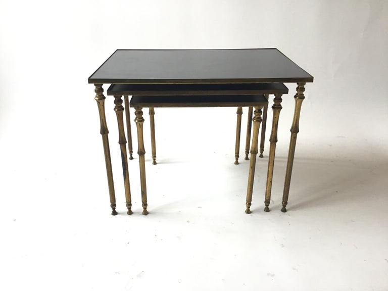 1950s French brass and glass nesting tables.