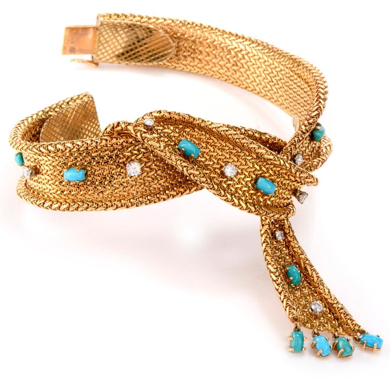 What a great way to Winterize your jewelry wardrobe!  The beautifully designed mesh Scarf bracelet is adorned throughout with 9 evenly spaced  oval turquoise beads and accented with 12 round brilliant cut diamonds weighing approx. 0.96 carats and