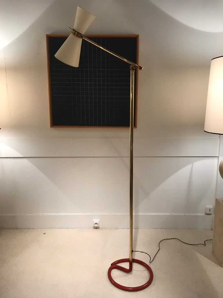 1950s French floor lamp in brass. Adjustable height and directional light Good vintage condition.