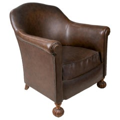 1950s French Leather Armchair with Ornate Carved Wood