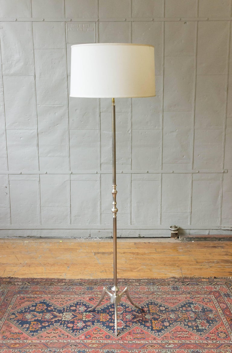 Mid Century silver plated floor lamp on tripod base with fluted stem.  Price includes polishing or plating and new wiring. Please allow 2 to 3 weeks for completion. Not sold with shade (photographed with 10 inch H x 18 inch Diameter shade).