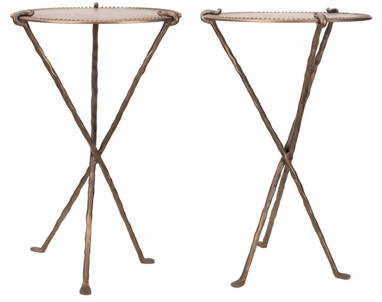 1950s French pair of bronze design tables with three crossed legs.