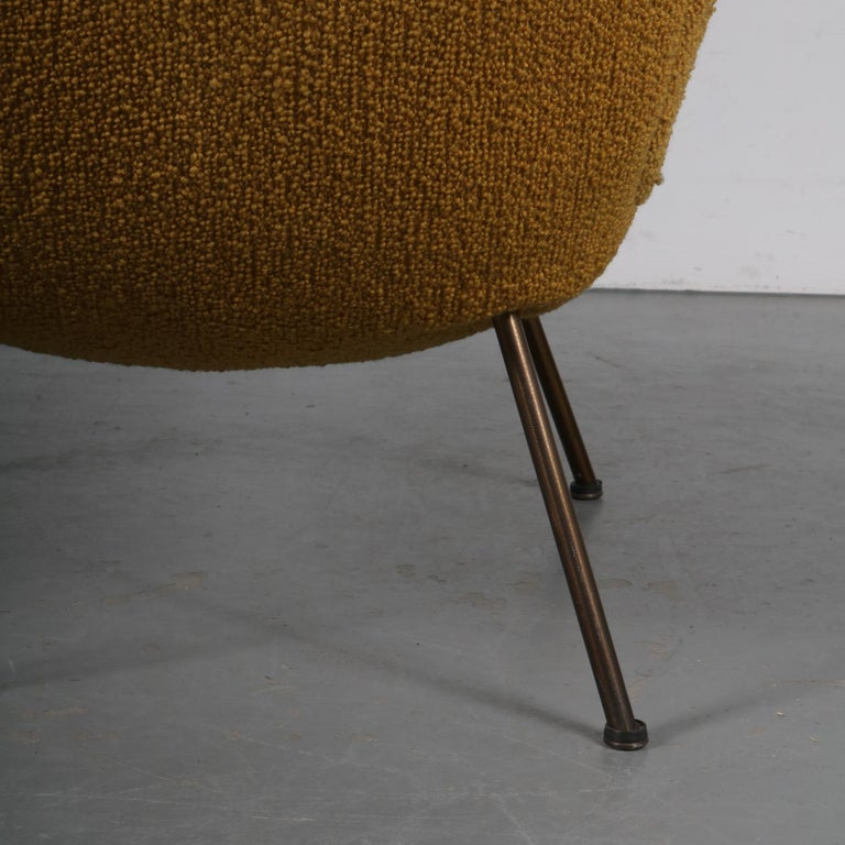 """This is a beautiful and original """"Madame"""" chair designed by Fritz Neth, manufactured by Correcta in Germany, circa 1950.  This lovely piece is made of high quality fabric that is soft to the touch, in a warm mustard yellow color. It has four metal"""