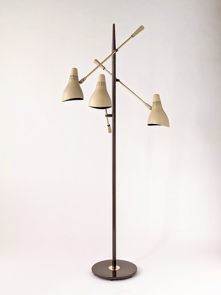 Playfull sculptural iconic Triennale 3 arm floor lamp designed by Gerald Thurston for Lightolier. The shape of the molded phenolic plastic shades were intended to resemble Apollo rockets nose cone capsule complimented by the stilleto styled pole for