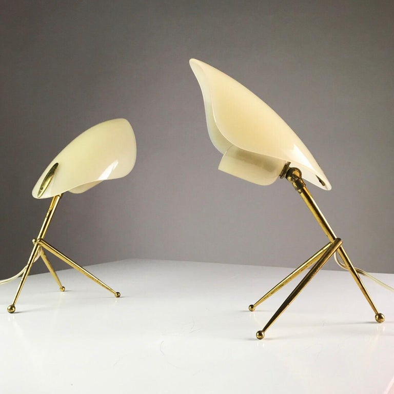Made in the 1950s by WKR Offenbach am Main in Germany.   Elegant and sophisticated table lights from the Stilnovo modernistic era made from solid brass and thick off white perspex shades.   The shape of the large perspex reminds of the leaf and