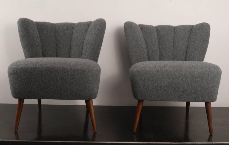Fully restored armless channel back club chairs with hairpin legs. The fabric is a grey boiled wool from Holland and Sherry.