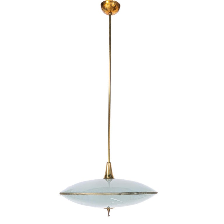 This elegant piece consisting of a brass frame and 2 unique frosted and satin glass reflector/saucers.  The lower round curved glass reflector with 6 grain harvest motifs and a gold-colored ring mounts below a round satin blue glass reflector.