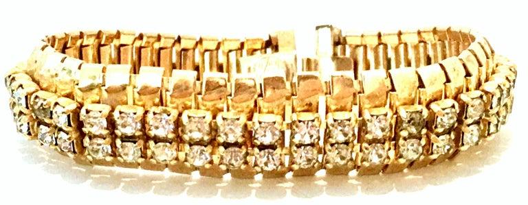 1950'S Gold Plate & Swarovski Crystal Rhinestone Link Bracelet By, Jewels By Julio. Features prong set crystal clear rhinestones and locking clasp. Signed on the underside, Jewels By Julio.