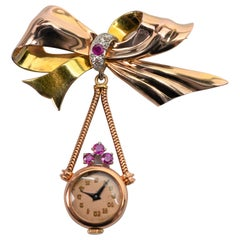 1950s Gold Pendant Watch Brooch with Rubies