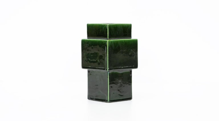 Vase by Ettore Sottsass, Italy, 1959.  Nicely shaped deep green ceramic vase designed by famous Italian Ettore Sottsass. He was an architect and designer of the late 20th century. His body of designs included furniture, jewelry, glass, lighting