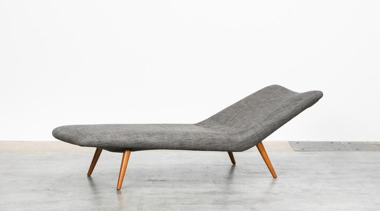 Grey textil, wooden base, Daybed by Theo Ruth for Artifort, Netherland, 1950s.  The daybed comes in clear lines and shape and is designed by Theo Ruth with a slight backrest raise. Our workshop has recently professionally upholstered this piece